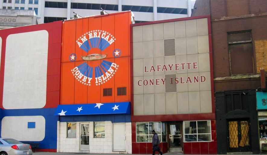 This Dec. 2, 2014 photo shows American Coney Island and Lafayette Coney Island, rival eateries located side by side in downtown Detroit. Coney-style hot dogs are a tradition in Michigan, served with onions, mustard and chili. The two restaurants were founded by brothers who were Greek immigrants in the early 20th century and many locals swear allegiance to one or the other. (AP Photo/Beth J. Harpaz)