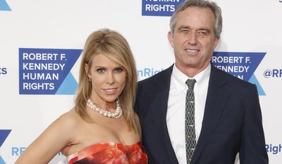 Activist Robert F. Kennedy, Jr. and his wife, actress Cheryl Hines, attend the Robert F. Kennedy Ripple of Hope Award ceremony, Tuesday, Dec. 16, 2014 in New York. (AP Photo/Jason DeCrow)