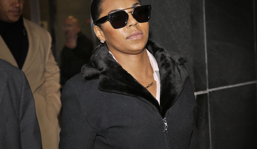 """Singer Ashanti leaves the courthouse after testifying at Devar Hurd's trial in New York, Tuesday, Dec. 16, 2014. Ashanti said in testimony at Hurd's trial Tuesday that she was """"disgusted"""" and """"absolutely scared"""" when she learned in July 2013 that Devar Hurd, who had been convicted of stalking her, had since been tweeting her X-rated messages and posed for a photo with her sister. (AP Photo/Seth Wenig)"""