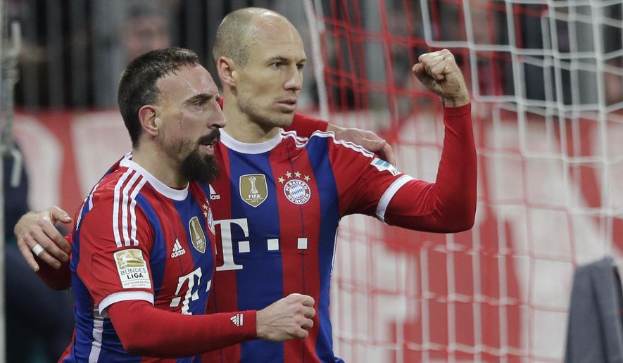 Bayern's Arjen Robben from the Netherlands, right, celebrates with teammate Franck Ribery from France after scoring his side's opening goal during the German first division Bundesliga soccer match between FC Bayern and SC Freiburg in the Allianz Arena in Munich, Germany, on Tuesday, Dec. 16, 2014. (AP Photo/Matthias Schrader)