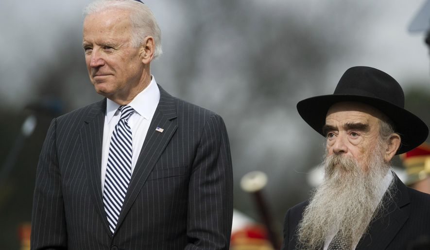 Vice President Joe Biden stands beside Rabbi Levi Shemtov, executive vice president of American Friends of Lubavitch (Chabab) as the National Menorah is lit during a ceremony marking the start of the celebration of Hanukkah, on the Ellipse near the White House in Washington, Tuesday, Dec. 16, 2014. (AP Photo/Cliff Owen)