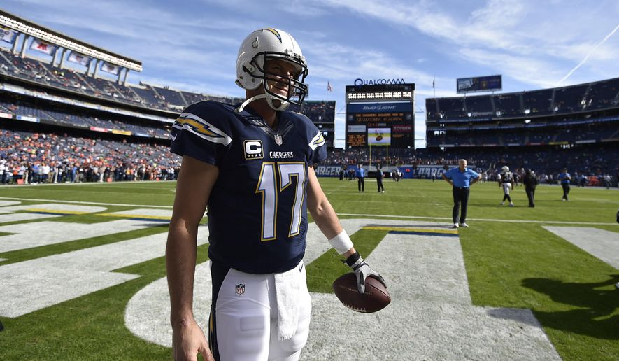 San Diego Chargers quarterback Philip Rivers warms up before an NFL football game against the Denver Broncos, Sunday, Dec. 14, 2014, in San Diego. (AP Photo/Denis Poroy)