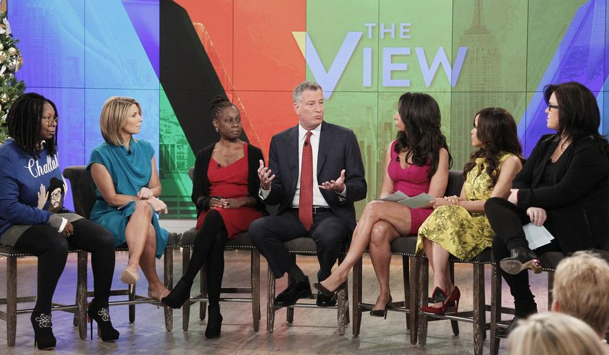 "In this image released by ABC,  New York Mayor Bill de Blasio, center, and his wife Chirlane McCray, center left, appear on ""The View,"" with hosts, Whoopi Goldberg, left, Nicolle Wallace, secomd left, Rosie O'Donnell, right, Rosie Perez, second right, and Rachel Feinstein, on Tuesday, Dec. 16, 2014, in New York. (AP Photo/ABC, Lou Rocco)"