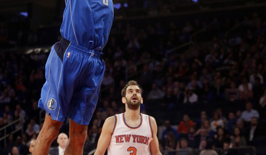 Dallas Mavericks' Tyson Chandler (6) dunks the ball in front of New York Knicks' Jose Calderon (3) during the first half of an NBA basketball game Tuesday, Dec. 16, 2014, in New York.  (AP Photo/Frank Franklin II)