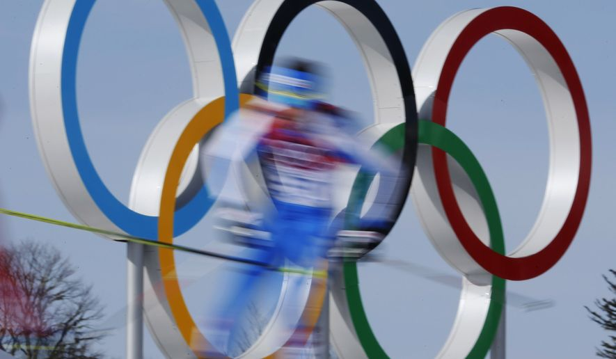 FILE - In this Feb. 23, 2014 file photo taken with slow shutter speed, athletes pass by the Olympic rings during the men's 50K cross-country race at the 2014 Winter Olympics in Krasnaya Polyana, Russia. The Sochi Olympics placed tenth on Google's list of 2014's fastest-rising global search requests, the company said Tuesday, Dec. 16, 2014.(AP Photo/Dmitry Lovetsky, File)