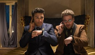 """This image released by Columbia Pictures shows James Franco (left) and Seth Rogen in a scene from """"The Interview."""" An email Tuesday from hackers calling themselves the Guardians of Peace hints that there will be attacks at theaters timed to the release of the Sony comedy opening Dec. 25 that depicts two bumbling journalists recruited by the CIA to assassinate North Korean leader Kim Jong-un. (Associated Press)"""
