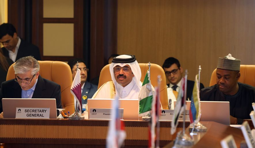 Qatari Oil Minister Mohammed bin Saleh al-Sada, center, speaks during the Gas Exporting Forum where gas exporting countries had their 16th ministerial meeting in Doha, Qatar, Tuesday, Dec. 16, 2014. (AP Photo/Osama Faisal)
