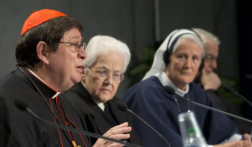 Brazilian Cardinal Joao Braz de Aviz, Prefect of the Congregation for Institutes of Consecrated Life and Societies of Apostolic Life, left, flanked by Sister Sharon Holland, center, and Mother Agnes Mary Donovan, speaks during a press conference at the Vatican, Tuesday, Dec. 16, 2014. The Vatican released the long-awaited results of its controversial three-year investigation into U.S. women's religious orders, and the report was remarkable for what it didn't say. (AP Photo/Andrew Medichini)