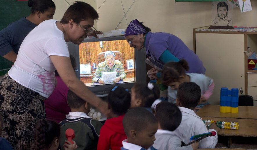 "Teachers and students listen to a live, nationally broadcast speech by Cuba's President Raul Castro about the country's restoration of relations with the United States, at a school in Havana, Cuba, Wednesday, Dec. 17, 2014. Castro said profound differences remain between Cuba and the U.S. in areas such as human rights, foreign policy and questions of sovereignty, but that the countries have to learn to live with their differences ""in a civilized manner."" (AP Photo/Ramon Espinosa)"