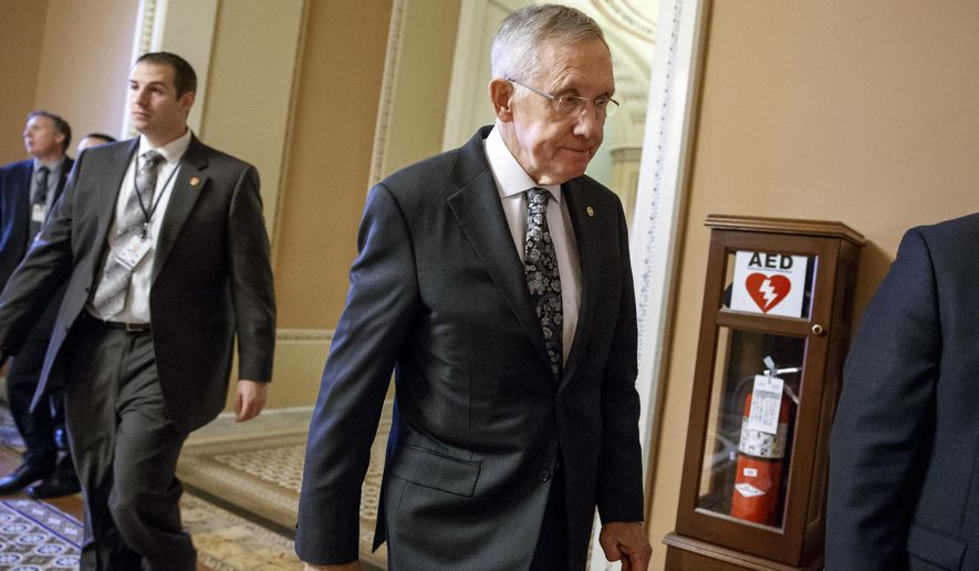 Senate Majority Leader Harry Reid of Nev. walks to meet with fellow Democrats on Capitol Hill in Washington, Tuesday, Dec. 16, 2014. When the 114th Congress convenes in January, Reid and his party will be the minority.  (AP Photo/J. Scott Applewhite)