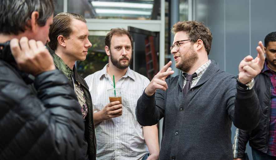 """This photo provided by Columbia Pictures - Sony shows, from left, 1st AD Jonathan Watson, DP Brandon Trost, Evan Goldberg,  and Seth Rogen on the set of Columbia Pictures' """"The Interview."""" (AP Photo/Columbia Pictures - Sony, Ed Araquel)"""