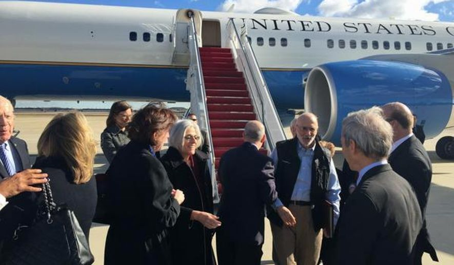 This handout photo from the Twitter account of Sen. Jeff Flake, R-Ariz. shows Alan Gross arriving at Andrews Air Force Base, Md., Wednesday, Dec. 17, 2014. The US and Cuba have agreed to re-establish diplomatic relations and open economic and travel ties, marking a historic shift in U.S. policy toward the communist island after a half-century of enmity dating back to the Cold War, American officials said Wednesday. The announcement came amid a series of sudden confidence-building measures between the longtime foes, including the release of American prisoner Alan Gross, as well as a swap for a U.S. intelligence asset held in Cuba and the freeing of three Cubans jailed in the U.S. Gross' wife Judy is at center. (AP Photo/Sen. Jeff Flake)
