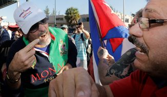Anti-Castro protester Lazaro Lozano (left) argues with a pro-Obama supporter in the Little Havana area of Miami Wednesday in the wake of an Obama administration announcement that could mean a major shift in U.S. policy toward Cuba. (Associated Press)