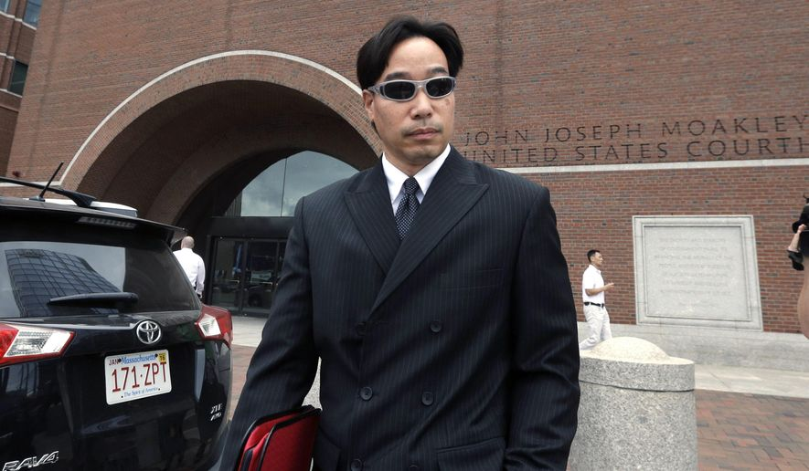 In this Sept. 11, 2014, file photo, Glenn Adam Chin, former supervisory pharmacist at the New England Compounding Center, departs federal court in Boston. Chin was among 14 people from the pharmaceutical  company arrested at their homes Wednesday, Dec. 17, 2014. Tainted steroids manufactured by the pharmacy were blamed  for a fungal meningitis outbreak that killed 64 people across the country. (AP Photo/Steven Senne, File)