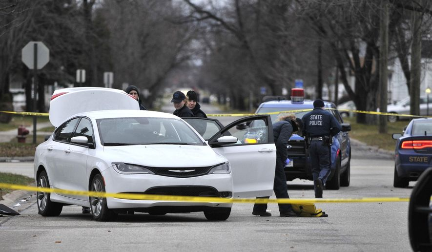 Michigan State Police investigate a police shooting, Wednesday, Dec. 17, 2014 in Port Huron, Mich. The incident occurred late Tuesday night. (AP Photo/The Times Herald, Mark R. Rummel)