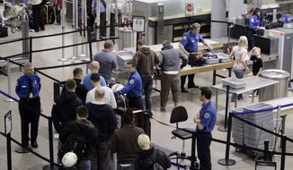 In this Monday, March 30, 2009 file photo, airline passengers line up at the TSA security check at Minneapolis-St. Paul International Airport in Minneapolis, Minn. Security checkpoints at Minneapolis-St. Paul International Airport are about to get a makeover. An $18 million plan calls for the consolidation of four checkpoints into one 10-lane checkpoint aimed at improving efficiency. (AP Photo/Kiichiro Sato, File)