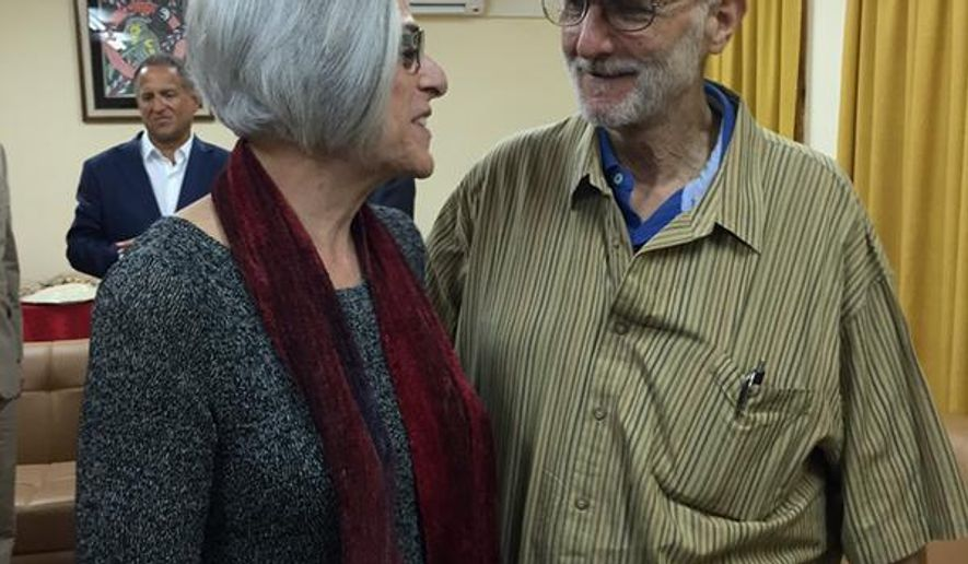 This handout photo from the Twitter account of Sen. Jeff Flake, R-Ariz. shows Alan Gross with his wife Judy before leaving Cuba, Wednesday, Dec. 17, 2014. The US and Cuba have agreed to re-establish diplomatic relations and open economic and travel ties, marking a historic shift in U.S. policy toward the communist island after a half-century of enmity dating back to the Cold War, American officials said Wednesday. The announcement came amid a series of sudden confidence-building measures between the longtime foes, including the release of American prisoner Alan Gross, as well as a swap for a U.S. intelligence asset held in Cuba and the freeing of three Cubans jailed in the U.S. (AP Photo/Sen. Jeff Flake)