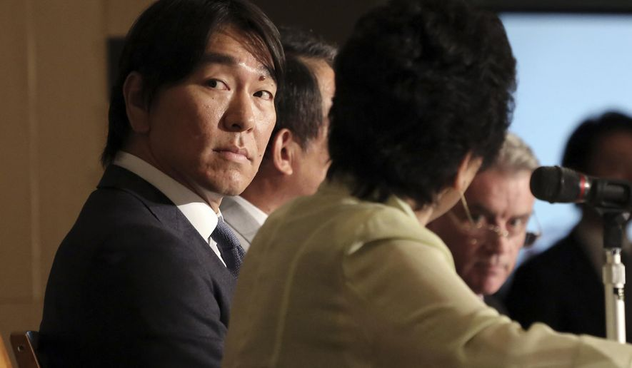 Former New York Yankees outfielder and 2009 World Series MVP Hideki Matsui watches a screen during a press conference at the Foreign Correspondents  Club of Japan in Tokyo, Wednesday, Dec. 17, 2014. Matsui will team up with former New York Yankees teammate Derek Jeter to hold a baseball charity event in support children affected by the 2011 earthquake and tsunami. (AP Photo/Eugene Hoshiko)