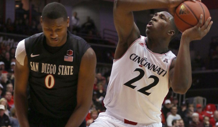 Cincinnati's Coreontae DeBerry (22) shoots past San Diego State's Skylar Spencer in the first half of their NCAA college basketball game in Cincinnati Wednesday, Dec. 17, 2014. (AP Photo/Tom Uhlman)