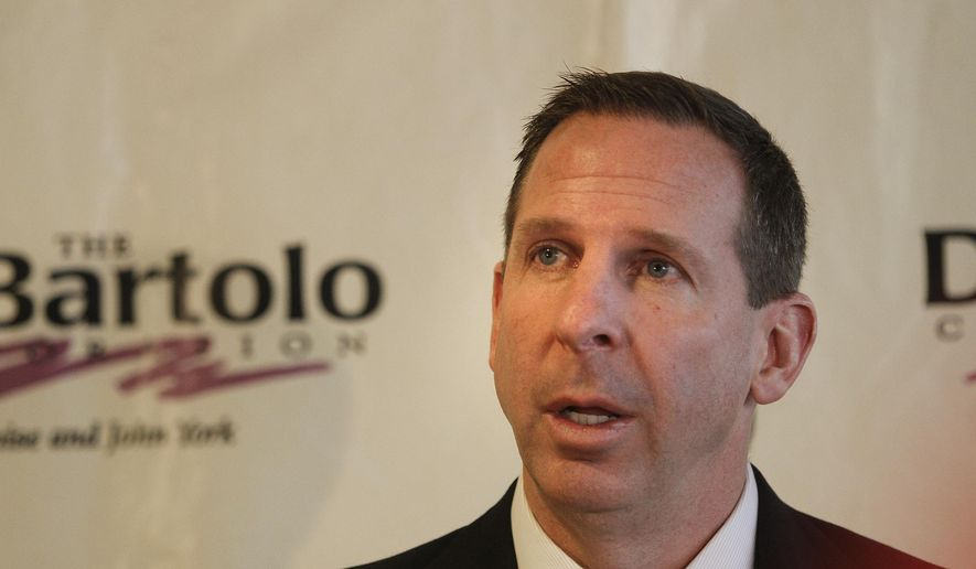 """Youngstown State University's new head football coach Bo Pelini is addresses the media Wendesday morning, Dec. 17, 2014, at Stambaugh Stadium in Youngstown, Ohio.  Pelini was introduced as the Penguins coach Wednesday and said his goal is to make """"this the best football program in the country.""""  (AP Photo/The Vindicator, Robert K. Yosay)   -30-"""