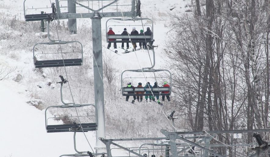 In this Friday, Nov. 15, 2014 photo, skiers and boarders ride a high-speed lift at the Granite Peak Ski Area in Wausau, Wis. The owner and president of Granite Peak in Rib Mountain State Park is proposing a $50 million expansion that would add lodging and more than a dozen new ski runs to the grounds. Charles Skinner wants to expand the leased portion of the ski area from 415 acres to 565 acres to add more than a dozen new novice and intermediate runs. (AP Photo/The Wausau Daily Herald, Dan Young)