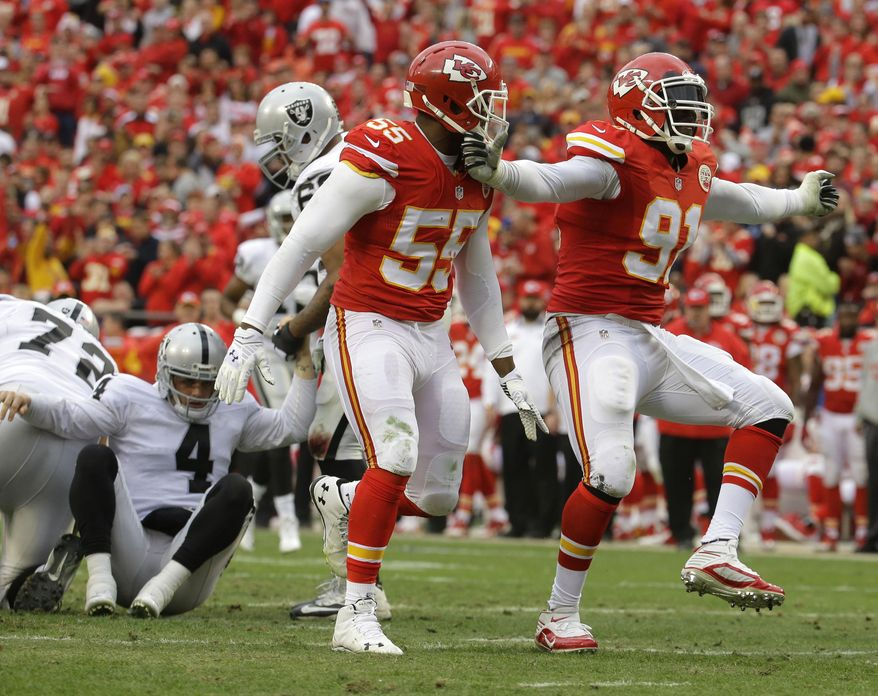 Kansas City Chiefs outside linebacker Tamba Hali (91) celebrates after sacking Oakland Raiders quarterback Derek Carr (4) during the second half of an NFL football game in Kansas City, Mo., Sunday, Dec. 14, 2014. (AP Photo/Charlie Riedel)