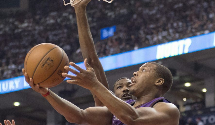 Toronto Raptors' Kyle Lowry drives to the basket in front of Brooklyn Nets' Cory Jefferson during the first half of an NBA basketball game Wednesday, Dec. 17, 2014, in Toronto. (AP Photo/The Canadian Press, Frank Gunn)