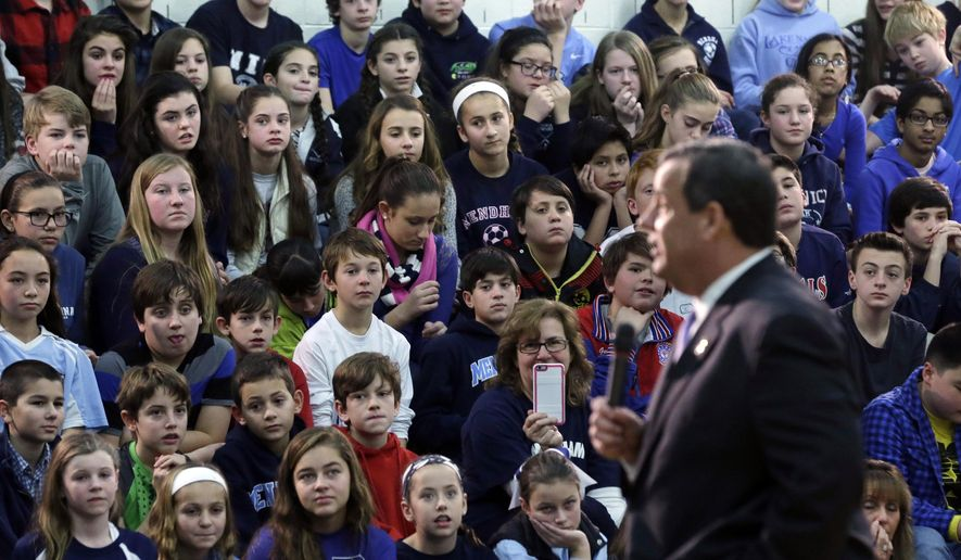 Students, teachers and parents at Mendham Township Middle School listen to an address by New Jersey Gov. Chris Christie Wednesday, Dec. 17, 2014, in Mendham Township, N.J. The school was designated a School of Excellence by the U.S. Department of Education. (AP Photo/Mel Evans)