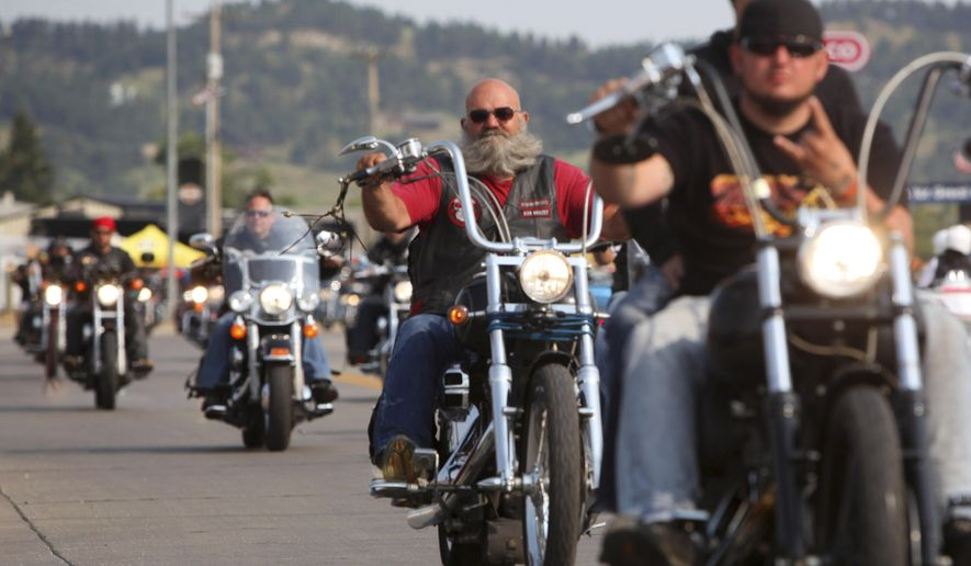 FILE - In this Aug. 4, 2014 file photo, riders flood the streets of Sturgis, S.D., for the opening day of the 74th Annual Motorcycle Rally. City officials have begun discussing how to handle traffic during next year's rally, and some residents have expressed concern about certain proposed changes. The late-summer rally is expected to draw more than 1 million people next year. (AP Photo/Toby Brusseau, File)