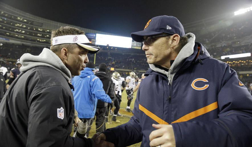 New Orleans Saints head coach Sean Payton and Chicago Bears head coach Marc Trestman talks after an NFL football game Monday, Dec. 15, 2014, in Chicago. The Saints won 31-15. (AP Photo/Nam Y. Huh)