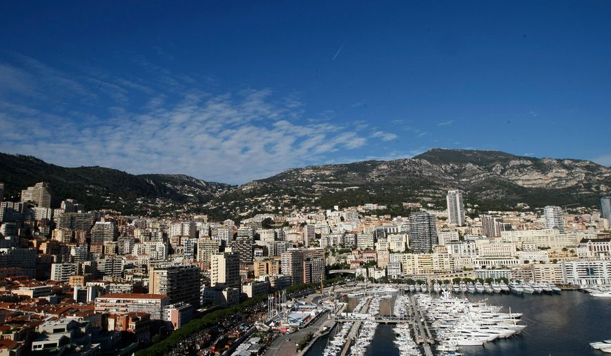 General view of Monaco and its yachts docked in the harbour, Friday, Dec. 12, 2014. For the first time since Monaco was founded in the 13th century, its royal family gave birth to twins on Wednesday, and dozens of cannons were fired to celebrate. Monaco's Princess Charlene had a girl first and a boy second, but the boy will be the principality's future ruler, reflecting the male priority of Monaco's laws of succession.  (AP Photo/Claude Paris)
