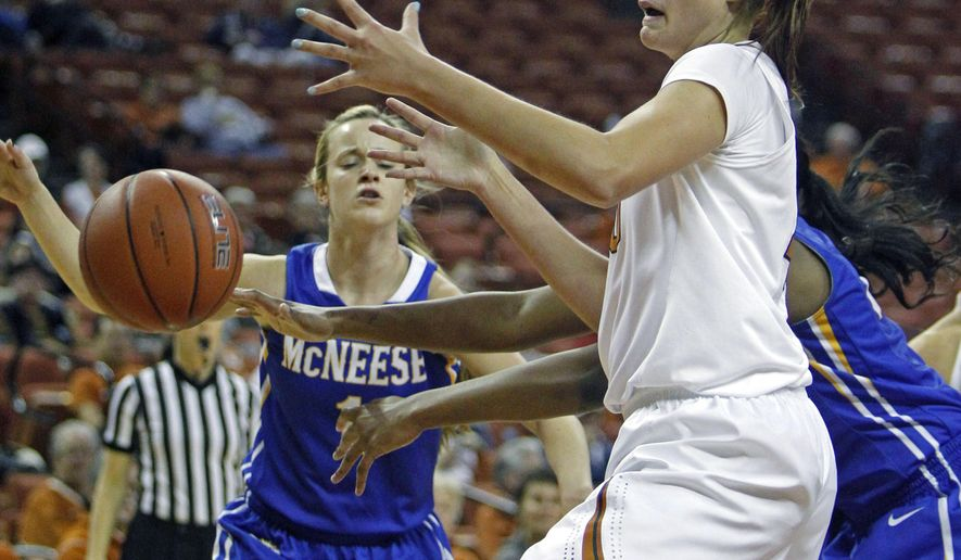 Texas forward Kelsey Lang, right, goes for a loose ball against McNeese State during the first half of an NCAA college basketball game, Wednesday, Dec. 17, 2014, in Austin, Texas. (AP Photo/Michael Thomas)
