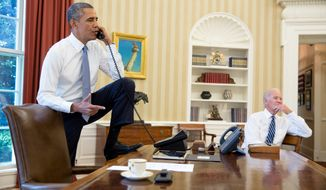 President Barack Obama talks on the phone in the Oval Office with Speaker of the House Boehner, Saturday, August 31, 2013. Vice President Joe Biden listens at right.