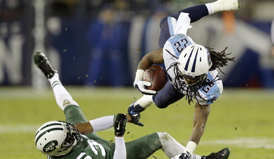 Tennessee Titans running back Dexter McCluster (22) is brought down by New York Jets cornerback Darrin Walls (30) in the second half of an NFL football game Sunday, Dec. 14, 2014, in Nashville, Tenn. (AP Photo/James Kenney)