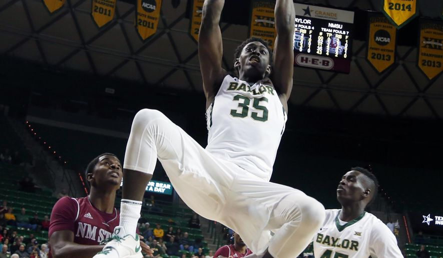 Baylor forward Johnathan Motley (35) scores over New Mexico State guard Braxton Huggins, left, during the first half of an NCAA college basketball game, Wednesday, Dec. 17, 2014, in Waco, Texas. (AP Photo/Waco Tribune Herald, Rod Aydelotte)