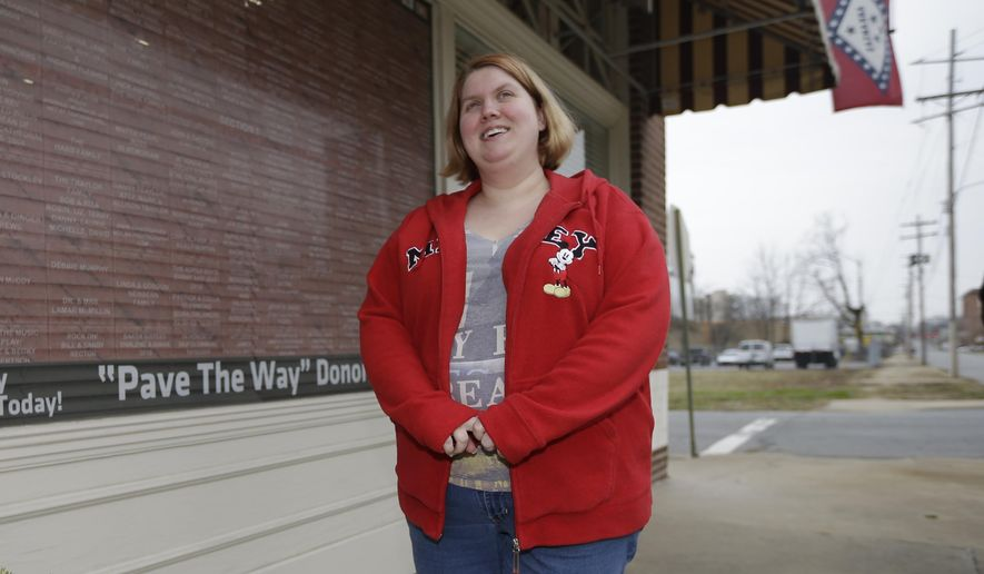In this photo taken Dec. 11, 2014, Arwen Dover is interviewed near her employer's store in Little Rock, Ark. Dover participates in a program in Arkansas that expand its Medicaid program in a way that many Republicans found acceptable. The state bought private insurance for low-income people instead of adding them to the rolls of a system GOP lawmakers called bloated and inefficient. (AP Photo/Danny Johnston)