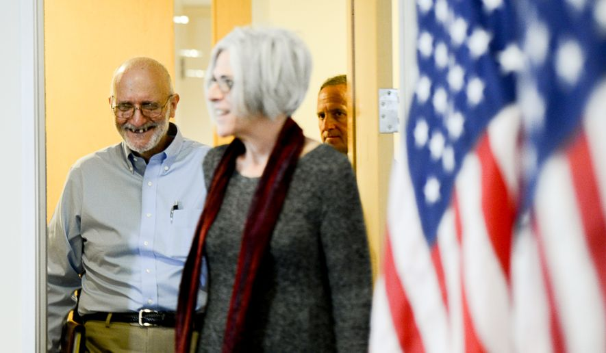 Alan Gross stands with his wife Judy and gives remarks to the media after being released from a Cuban prison where he was held for five years, Washington, D.C., Wednesday, Dec. 17, 2014. Gross was arrested while in Cuba while working as a U.S. government subcontractor for the U.S. Agency for International Development (USAID). (Andrew Harnik/The Washington Times)
