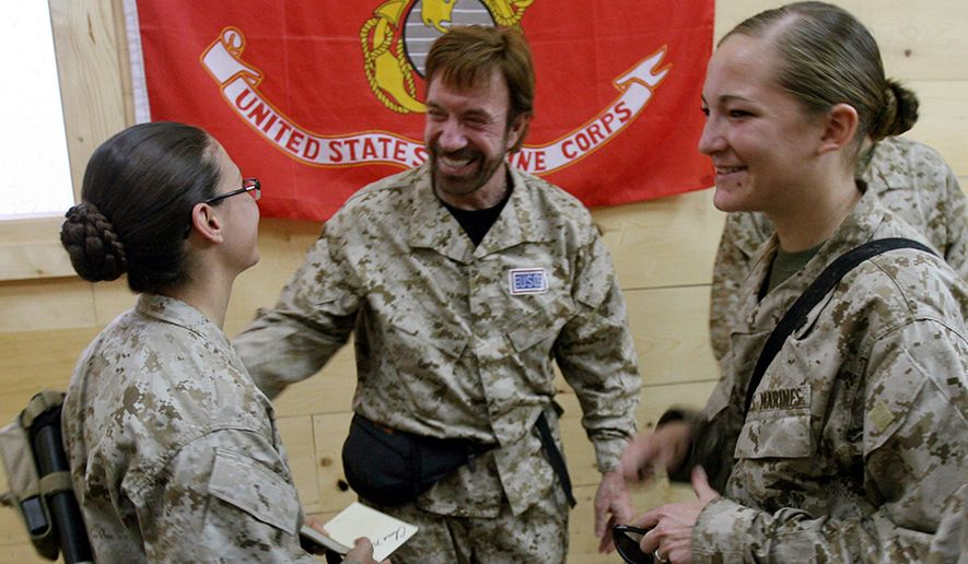 "Chuck Norris joined the United States Air Force as an Air Policeman (AP) in 1958 and was sent to Osan Air Base, South Korea. It was there that Norris acquired the nickname Chuck and began his training in Tang Soo Do (tangsudo), an interest that led to black belts in that art and the founding of the Chun Kuk Do (""Universal Way"") form. When he returned to the United States, he continued to serve as an AP at March Air Force Base in California. Norris was discharged in August 1962. This image provided by the US Marine Corps Wednesday Nov. 1, 2006 shows US Marines and sailors from the California-based Regimental Combat Team 7 meeting film action star Chuck Norris Oct. 31, 2006, at Al Asad air base in Iraqs Al Anbar Province. Part of a United Services Organizations (USO) tour, Norris and fellow action star Marshall Teague spent several days touring Iraq to meet US service members. RCT-7 is the U.S. military unit responsible for training Iraqi Security Forces and providing security in more than 30,000 square miles of territory in western Al Anbar  an area which spans from the Syria/Jordan borders and East to the Euphrates River. (AP Photo/Staff Sgt. Jim Goodwin - US Marine Corps)"