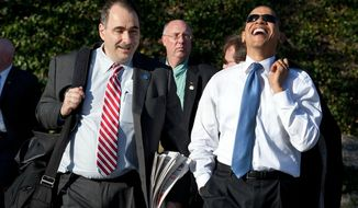 President Barack Obama laughs while walking with Senior Advisor David Axelrod on March 18, 2009. (Official White House Photo by Pete Souza)