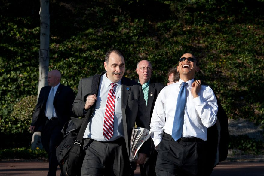 President Barack Obama laughs while walking with Senior Advisor David Axelrod following an event at the Costa Mesa Town Hall at OC Fair & Event Center in Costa Mesa, Calif., March 18, 2009. (Official White House Photo by Pete Souza)