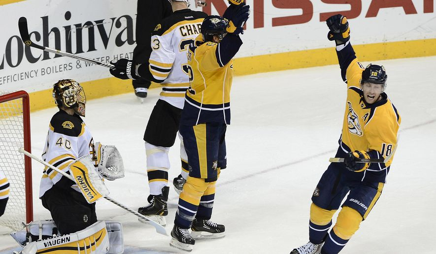 Nashville Predators center Mike Fisher, center, and James Neal (18) celebrate after Fisher scored a goal against Boston Bruins goalie Tuukka Rask (40), of Finland, in the second period of an NHL hockey gameTuesday, Dec. 16, 2014, in Nashville, Tenn. (AP Photo/Mark Zaleski)
