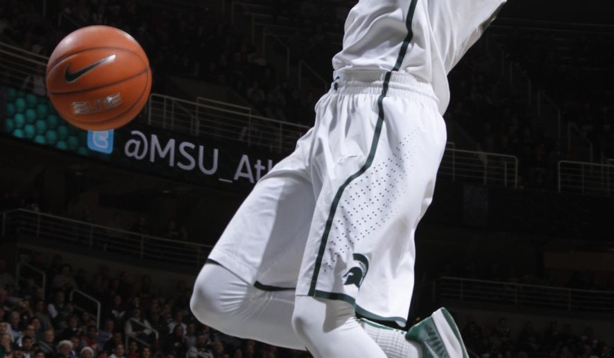 Michigan State's Branden Dawson dunks against Eastern Michigan during the first half of an NCAA college basketball game, Wednesday, Dec. 17, 2014, in East Lansing, Mich. (AP Photo/Al Goldis)