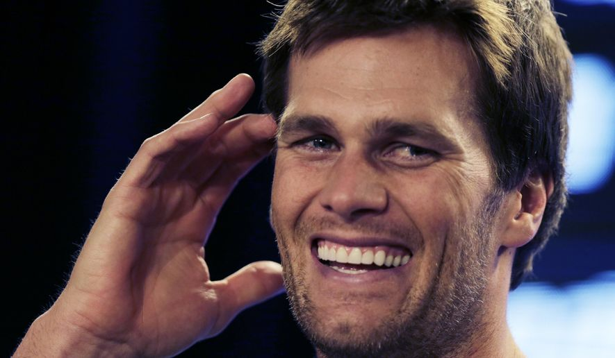New England Patriots quarterback Tom Brady laughs during a news conference prior to an NFL football practice in Foxborough, Mass., Wednesday, Dec. 17, 2014. (AP Photo/Charles Krupa)