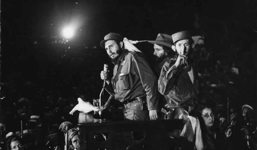 "FILE - In this Jan. 8, 1959 file photo, Cuba's Fidel Castro speaks to supporters at the Batista military base ""Columbia,"" now known as Ciudad Libertad, in Cuba. The Cuban revolution triumphed on Jan. 1, 1959 after dictator Fulgencio Batista fled the country and Fidel Castro and his band of rebels descended from the island's eastern mountains, where they waged a guerrilla war against government troops. The United States soon recognized the new government, but two years later on Jan. 3, 1961 broke relations with Cuba and closed its embassy. On Wednesday, Dec. 17, 2014, the U.S. and Cuba agreed to re-establish diplomatic relations and open economic and travel ties, marking a historic shift in U.S. policy toward the communist island after a half-century of enmity dating back to the Cold War. (AP Photo, File)"