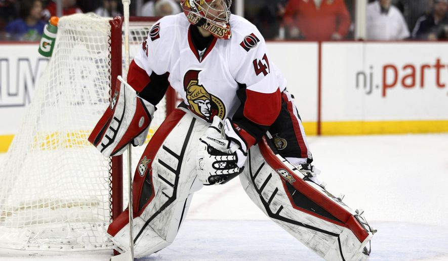 Ottawa Senators goalie Craig Anderson collects the puck during the second period of an NHL hockey game against the New Jersey Devils, Wednesday, Dec. 17, 2014, in Newark, N.J. (AP Photo/Julio Cortez)