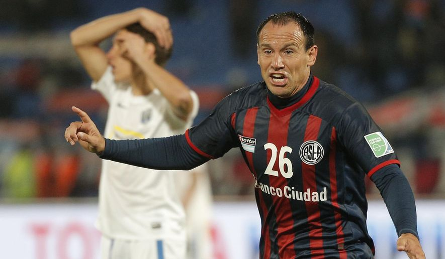 San Lorenzo's Mauro Matos celebrates after scoring during the semi final soccer match between Auckland City FC and San Lorenzo at the Club World Cup soccer tournament in Marrakech, Morocco, Wednesday, Dec. 17, 2014. (AP Photo/Christophe Ena)