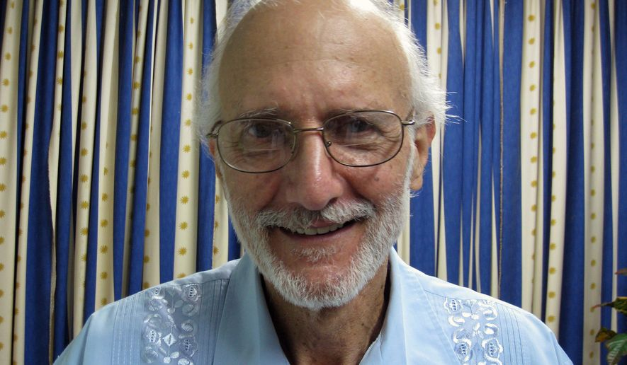 FILE - In this Nov. 27, 2012 file photo provided by James L. Berenthal, jailed American Alan Gross poses for a photo during a visit by Rabbi Elie Abadie and U.S. lawyer James L. Berenthal at Finlay military hospital as he serves a prison sentence in Havana, Cuba. AP sources: American Alan Gross released from Cuba after 5 years in prison.  (AP Photo/James L. Berenthal, File)