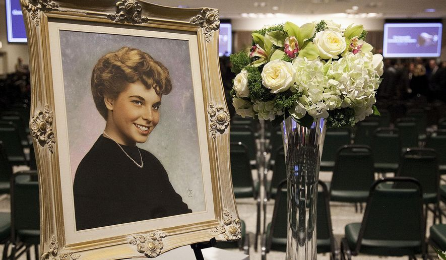 A early portrait of the late Illinois Comptroller Judy Baar Topinka is seen before a public memorial Wednesday, Dec. 17, 2014, at a union hall Countryside, Ill., attended by the state's top leaders, lawmakers and local leaders. Topinka died Dec. 10, 2014, at age 70 after suffering complications from a stroke. She had won a second full term in November. (AP Photo/Sun-Times Media, Ashlee Rezin)  MANDATORY CREDIT, MAGS OUT, NO SALES
