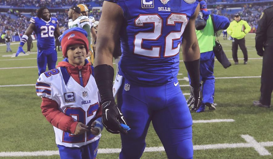 Buffalo Bills Fred jackson walks off the field with his son after the Bills defeated the Green Bay Packers  21-13 in the NFL football game  at Ralph WIlson Stadium on Sunday, Dec. 14, 2014,  in Orchard Park, NY. (AP Photo/The Buffalo News, Harry Schull, Jr.)  TV OUT; MAGS OUT; MANDATORY CREDIT; BATAVIA DAILY NEWS OUT; DUNKIRK OBSERVER OUT; JAMESTOWN POST-JOURNAL OUT; LOCKPORT UNION-SUN JOURNAL OUT; NIAGARA GAZETTE OUT; OLEAN TIMES-HERALD OUT; SALAMANCA PRESS OUT; TONAWANDA NEWS OUT
