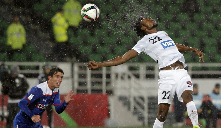 10ThingstoSeeSports - Western Sydney Wanderers' Seyi Adeleke, right, jumps to head the ball as Cruz Azul's Mauro Formica looks on during their soccer match at the Club World Cup soccer tournament in Rabat, Morocco, Saturday, Dec. 13, 2014. (AP Photo/Christophe Ena, File)